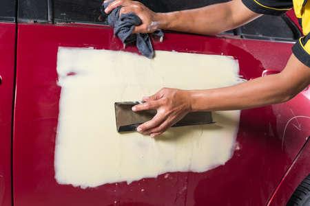 auto repair: Auto body repair series : Sanding filler Stock Photo