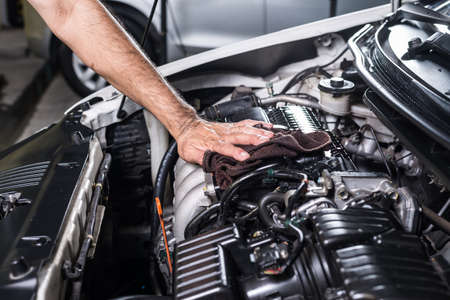 automotive repair: Cleaning car engine Stock Photo