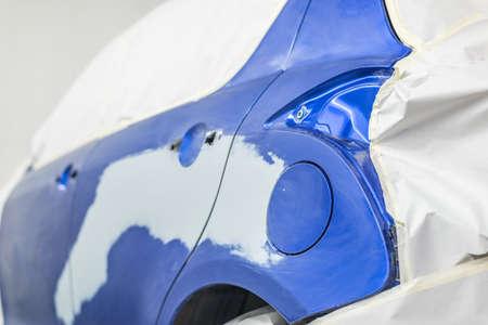 repaint: Auto body repair series : Masked car before repaint