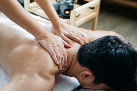 spa therapy: Thai massage series : Back and shoulder massage Stock Photo