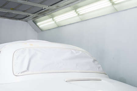 buffing: Auto body repair series : Masked white car before repaint Stock Photo