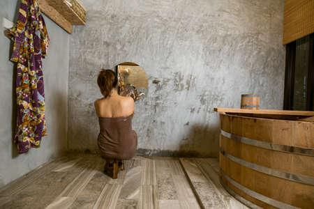 ryokan: Onsen series : Unrecognizable woman taking shower Stock Photo