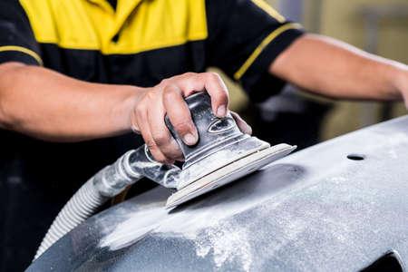 Auto body repair series : Sanding front bumper Фото со стока - 51523767