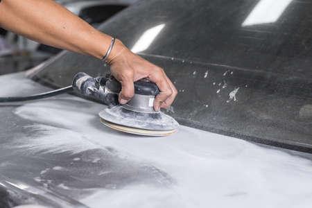 auto repair: Auto body repair series : Sanding trunk paint Stock Photo