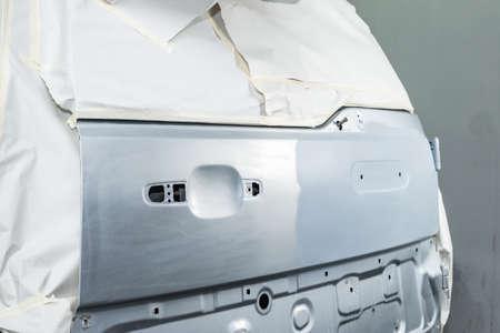 auto repair: Auto body repair series : Masking car preparing for paint work