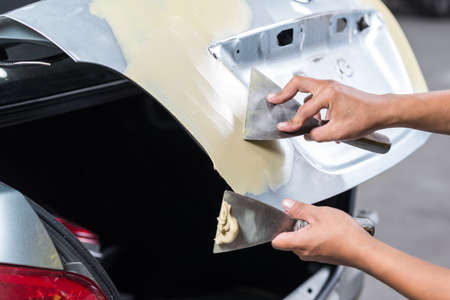Auto body repair series : Working on filler Stock Photo