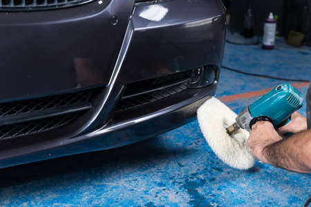 auto repair: Car polishing series : Polishing blue car Stock Photo