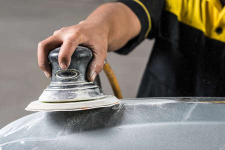 auto repair: Auto body repair series : Sanding front bumper
