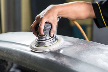 auto repair: Auto body repair series : Sanding rear bumper