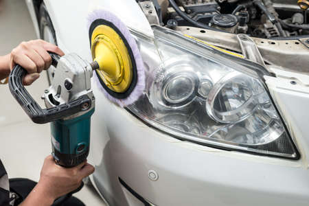 buffing: Car polishing series : Headlight polishing Stock Photo