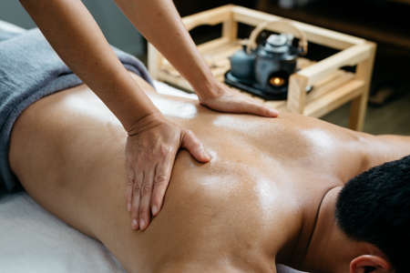 adult massage: Thai massage series : Back and shoulder massage Stock Photo