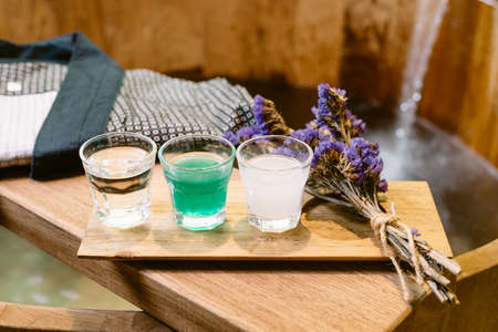onsen: Onsen series : wooden bathtub with sample of mineral water