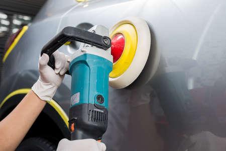 detailing: Car detailing series : Worker waxing grey car