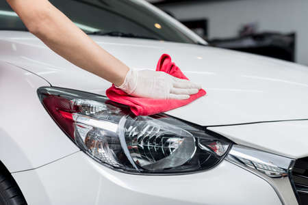 wash hands: Car detailing series : Worker cleaning white car Stock Photo