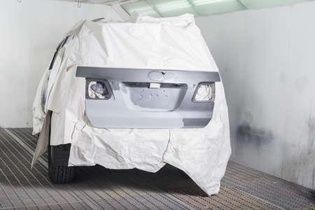 auto repair: Auto body repair series : Masked gray suv before repaint