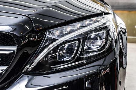 Car polishing series : Clean black car Reklamní fotografie