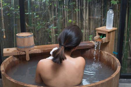 onsen: Onsen series : Unrecognizable woman in wooden bathtub Stock Photo