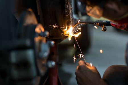 low key lighting: Auto body repair series : Welding in low key lighting