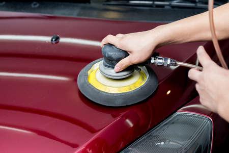 buffing: Car polishing series : Worker waxing red car