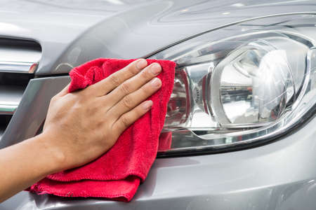 polishing: Car polishing series : Worker cleaning gray car Stock Photo