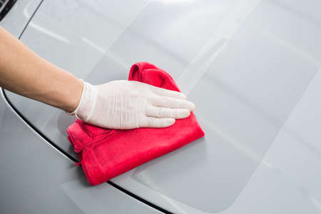 detailing: Car detailing series : Worker cleaning gray car