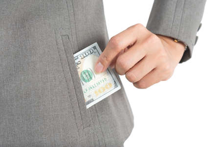 pulling money: Asian office worker series : Pulling money out of pocket Stock Photo