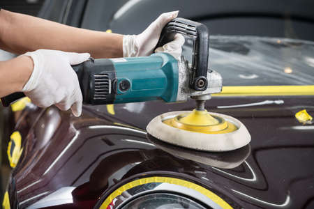 Car detailing series : Polishing brown car Stock Photo