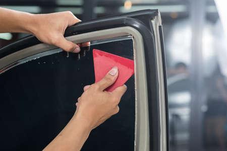 Car window tinting series : Installing car window tint Reklamní fotografie - 56485573