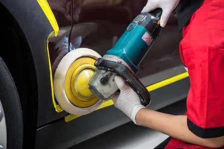 detailing: Car detailing series : Worker polishing brown car