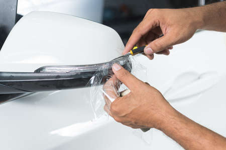 Paint protection film series : Cutting paint protection film on white car
