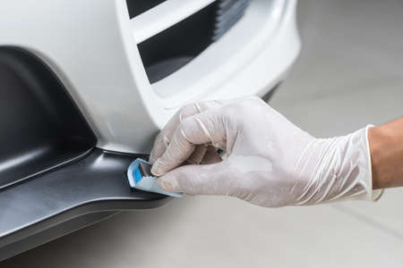 detailing: Car detailing series : Closeup of hand  coating plastic part Stock Photo