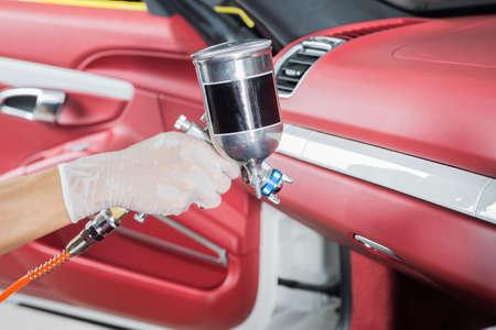 detailing: Car detailing series : Closeup of hand coating car seats