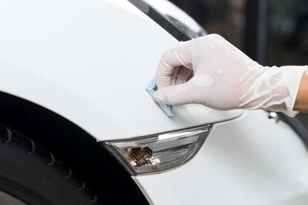 detailing: Car detailing series : Closeup of hand  coating white car paint