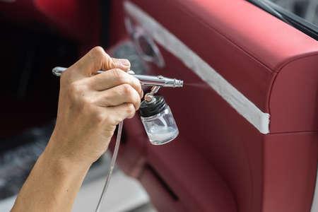 detailing: Car detailing series : Closeup of hand coating car door panel
