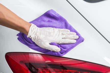 detailing: Car detailing series : Closeup of hand cleaning white car