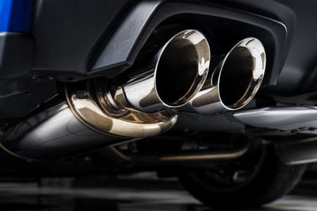 Car detailing series : Closeup of clean car muffler Standard-Bild