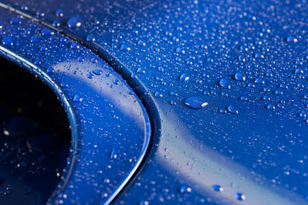 Car detailing series : Droplets on blue car bonnet Standard-Bild