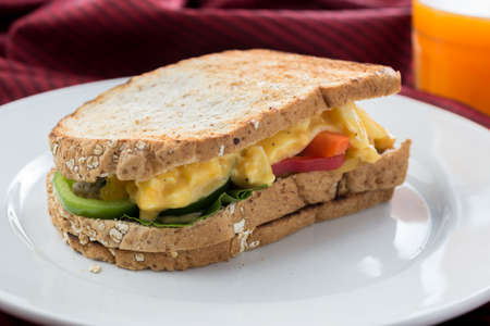bellpepper: Food series : Egg sandwich whole wheat bread on white plate