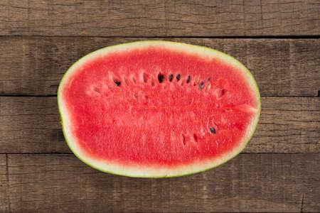 half  cut: Fruits series : Half cut watermelon on wooden plank table