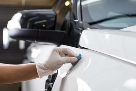 detailing: Car detailing series : Closeup of hand coating white car paint Stock Photo