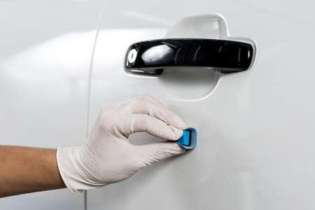 detailing: Car detailing series : Closeup of hand coating white car door