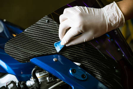 detailing: Motorcycles detailing series : Coating motorcycle carbon fiber parts Stock Photo