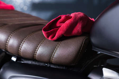 detailing: Motorcycles detailing series : Red microfiber cloth on vintage motorcycle seat
