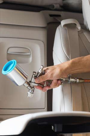 detailing: Car detailing series : Closeup of hand coating beige luxury car seat