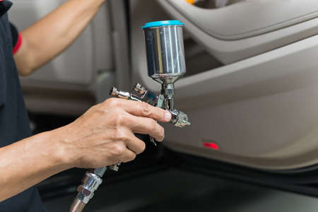 detailing: Car detailing series : Closeup of hand coating luxury car door panel
