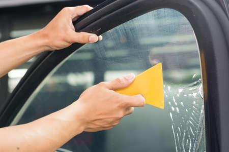 Car window tinting series : Installing car window tint Фото со стока - 69126689