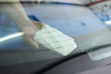 Car window tinting series : Cleaning window film Stock Photo