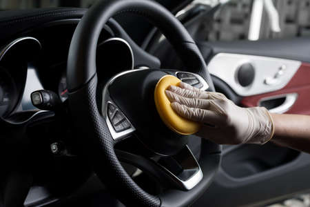 Car detailing series : Cleaning car steering wheel Stock Photo