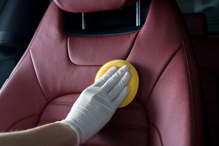 Car detailing series : Cleaning red car seat Imagens - 66088391