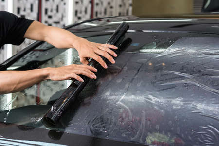 Car window tinting series : Installing car window tint Фото со стока - 66088421